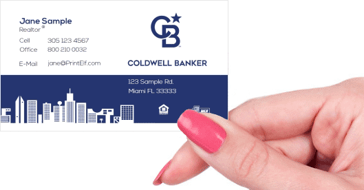 Hand holding business card - Coldwell Banker downtown business card