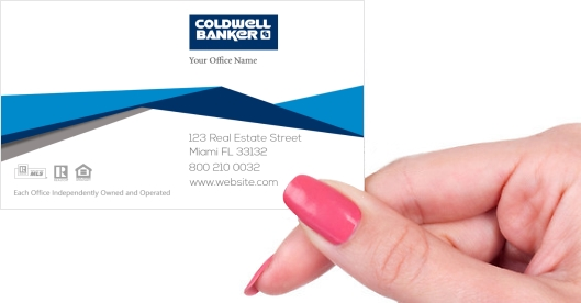 Hand holding business card - Coldwell Banker real estate modern business card