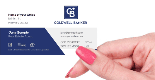 Hand holding business card - Coldwell Banker rebranded business card