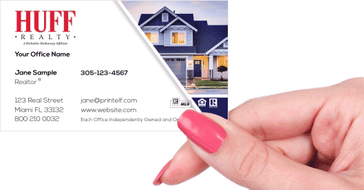 Hand holding business card - HUFF Realty residential business card