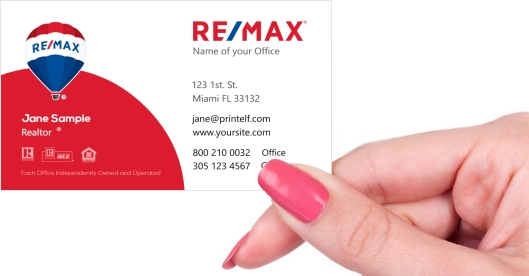 Hand holding business card - ReMax elegant business card