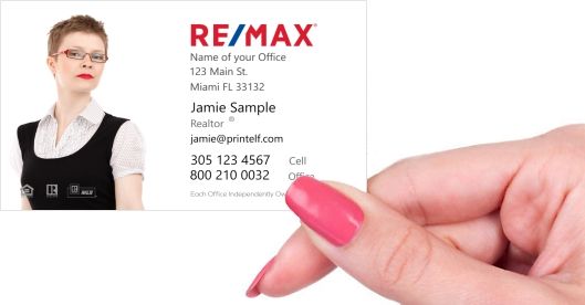 Hand holding business card - ReMax Realtor business card with house