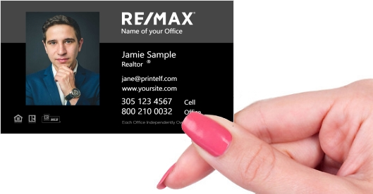 Hand holding business card - Remax black business card