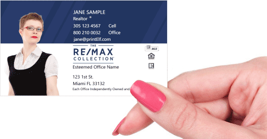 Hand holding business card - ReMax Collection business card