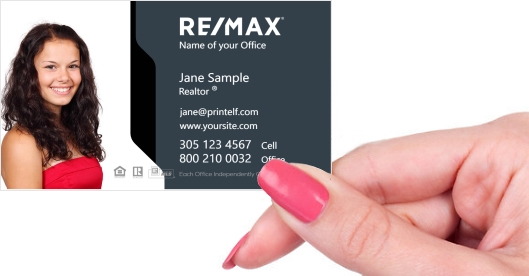 Hand holding business card - ReMax-dark-white-business-card