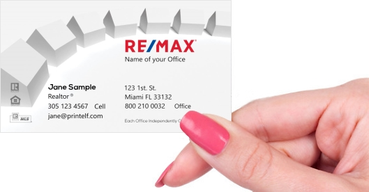 Hand holding business card - ReMax homes business cards