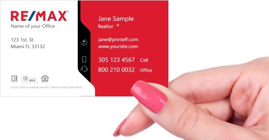Hand holding business card - ReMax-white-red-black-business card