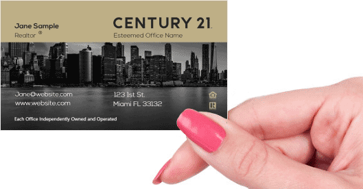 Hand holding business card - Century 21 Development business card