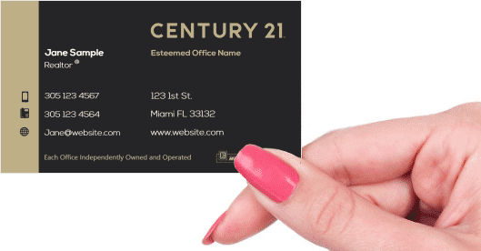 Hand holding business card - Century 21 Realty business cards