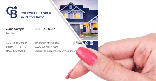 Hand holding business card - Coldwell Banker residential business card