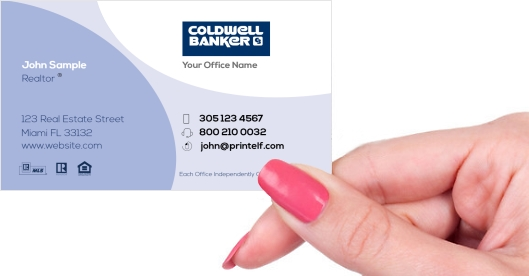 Hand holding business card - Coldwell banker agent business card
