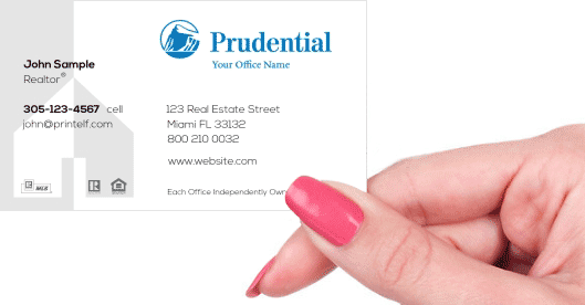 Hand holding business card - Prudential Commercial business card