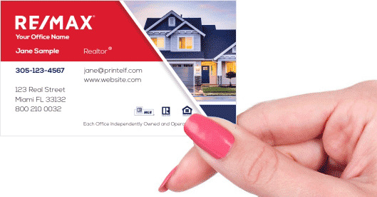 Hand holding business card - ReMax estate agent business card